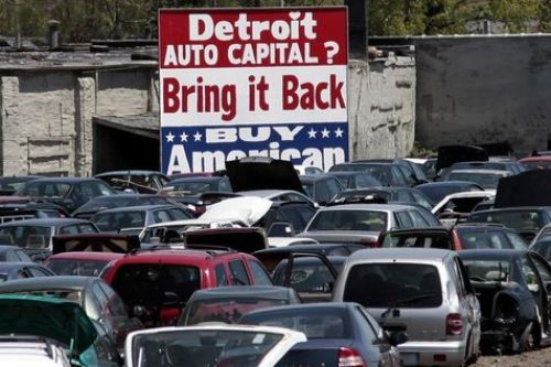 537104-a-large-buy-american-sign-in-support-of-detroit-s-auto-industry-is-seen-in-the-back-of-an-auto-scrap